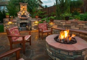 Outdoor entertaining area with fire pit and fireplace in Sandpoint Idaho